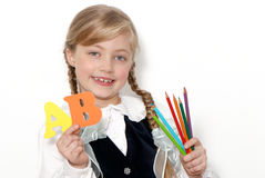 The nice schoolgirl with letters and pencils Stock Photo