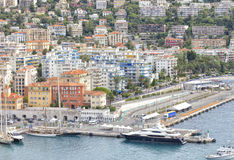 Nice sea port with luxury yachts, boats, wealthy houses Royalty Free Stock Photo