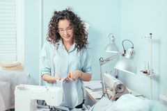 Nice Seamstress Wearing Glasses Cutting Fabric For Dress At Design Studio Royalty Free Stock Photo