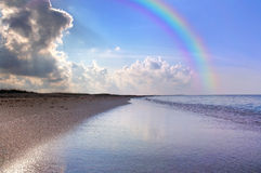Nice seascape with rainbow Stock Images