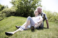 A nice senior couple outside having good time together stock photography