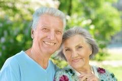 Nice senior couple. Portrait of a happy senior couple walking in park Stock Images