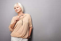 Nice senior woman in fashionable clothes. Stock Image