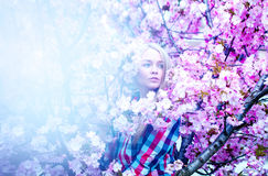 Nice sensual photo of cutie blonde woman in spring with flowers Royalty Free Stock Photo