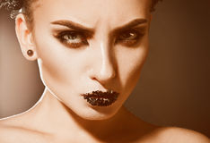 Nice serious woman wtih makeup and healthy skin looking at camer Stock Photography