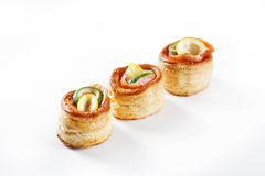 Nice set of rolled pancake canapes with lemon, lime and salmon o Royalty Free Stock Images