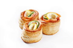 Nice set of rolled pancake canapes with lemon, lime and salmon o Stock Photos