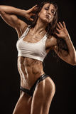 Nice sexy fitness woman showing abdominal muscles Royalty Free Stock Photo
