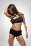 Nice sexy fitness woman showing abdominal muscles Royalty Free Stock Image
