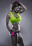Nice sexy fitness woman showing abdominal muscles Royalty Free Stock Images