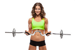 Nice woman doing workout with big dumbbell (retouched) Stock Photos