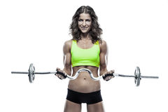 Nice sexy woman doing workout with big dumbbell (retouched) Royalty Free Stock Image