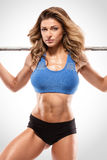 Nice woman doing workout with big dumbbell, retouched Stock Images