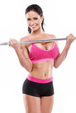Nice sexy woman doing workout with big dumbbell, retouched Royalty Free Stock Photos