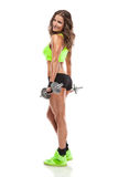 Nice woman doing workout with dumbbell stock photography