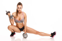 Nice woman doing workout with dumbbell Stock Photo