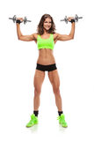 Nice sexy woman doing workout with dumbbell  (retouched) Stock Photos