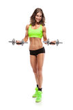 Nice woman doing workout with dumbbell (retouched) royalty free stock photo