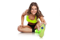 Nice sexy woman doing workout, stretching (retouched) Stock Photos