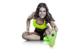 Nice sexy woman doing workout, stretching (retouched) Royalty Free Stock Photos
