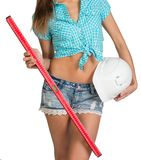 Nice sexy woman holding red building level and Stock Photo