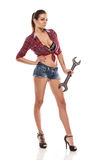 Nice woman mechanic holding wrench Royalty Free Stock Photography