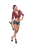 Nice sexy woman mechanic holding wrench Stock Image