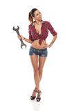 Nice sexy woman mechanic holding wrench Stock Photography