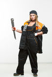Nice sexy woman mechanic holding wrench isolated over white background Royalty Free Stock Photos