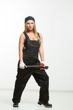 Nice sexy woman mechanic holding wrench isolated over white background Royalty Free Stock Photo