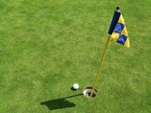 Nice Shot. A short putt to get home with flag stick Stock Photos