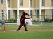 Nice shot. Batsman drives the ball sweetly at a cricket match Royalty Free Stock Photography
