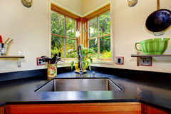 Nice sink with black counter top. Stock Images