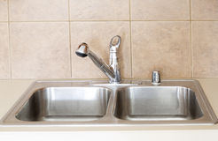 Nice sink in the kitchen. An nice sink in kitchen background royalty free stock images