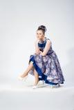 Nice sitting girl in bright dress Stock Photo