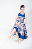 Nice sitting girl in bright dress Royalty Free Stock Image