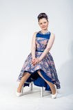 Nice sitting girl in bright dress Stock Photography