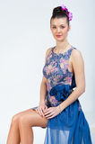 Nice sitting girl in bright dress Royalty Free Stock Images