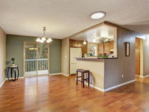 Nice sized dinning room with hardwood floor. Stock Images
