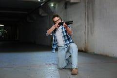 Nice skilled man training to shoot Stock Photo