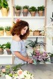 Nice skillful florist enjoying her work stock photo