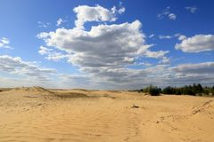 Nice sky in sandy desert. Blue sky with white clouds in sandy desert Stock Photos