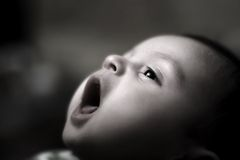 Nice small baby. Looking and yawns Royalty Free Stock Photo
