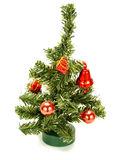 Nice small Christmas tree with red decoration Royalty Free Stock Image