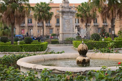 Nice small fountain on the territory of Palermo Cathedral. Water spray scatter in different directions. Palermo. Sicily Stock Photo