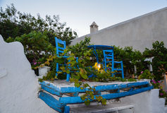 Nice small terrace in height with blue pedestal and 2 chairs Royalty Free Stock Photography