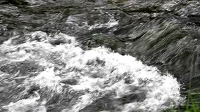 Nice small waterfall on mountain stream stock footage