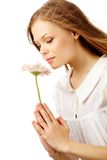 Nice smell. Image of fresh female holding nice herbera and smelling it Stock Image