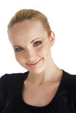 Nice Smile. Close-up of blond model smiling in black blouse on white Royalty Free Stock Photography