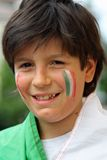 Nice smiling boy with flag before the World Cup football match Royalty Free Stock Image